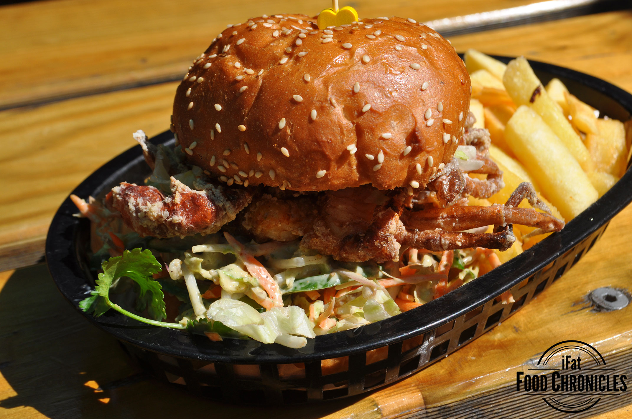 Soft shell crab burger with old bay coleslaw, ice-berg, sriarcha & chips