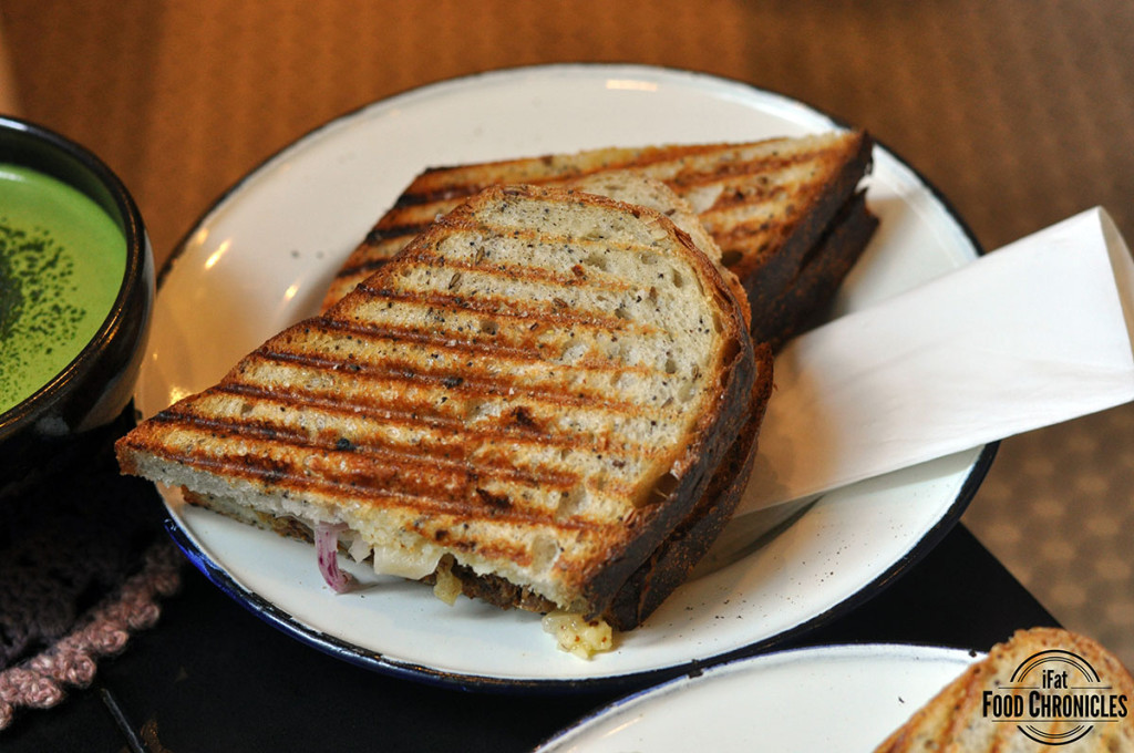 stock braised pork neck sandwich with pickled red onion, grilled ...